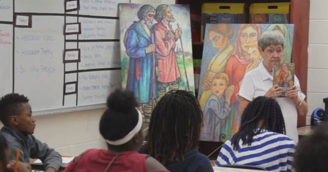 Presenting the Two Regimes book and artwork to a class